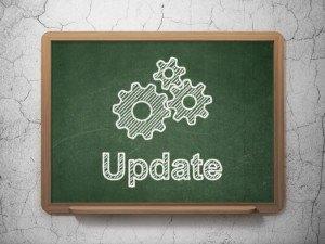 Web development concept: Gears and Update on chalkboard